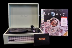 Garth Brooks Legacy Vinyl collection, a retro record player, and a gift card to Long Horn Steakhouse