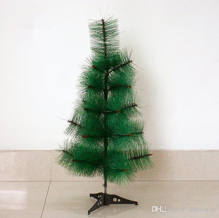 small decorated artificial christmas trees ...
