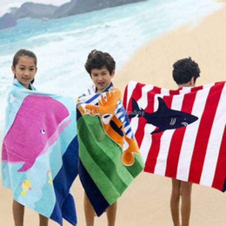 Resultado de imagen para niños envueltos en toalla playa