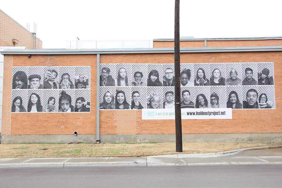 Plastered on the outside of the north wall are the faces of 32 students in Ms. Valery Smith's art class who attended a field trip to the Dallas Contemporary Art Museum.