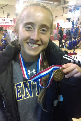 Hensley medals at state, first female in school history