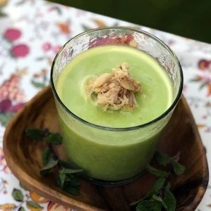 Pea soup topped with crab garnish