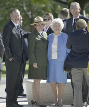 20802967 - former president george h.w. bush and barbara bush posing for camera in front of national world war ii memorial, washington, dc, may 8, 2007