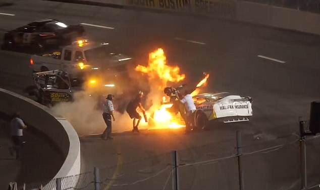 Mike Jones spiralled out of control and was sent crashing into the walls after he collided into another motorist, before his car went up in flamesat South Boston Speedway in Virginia