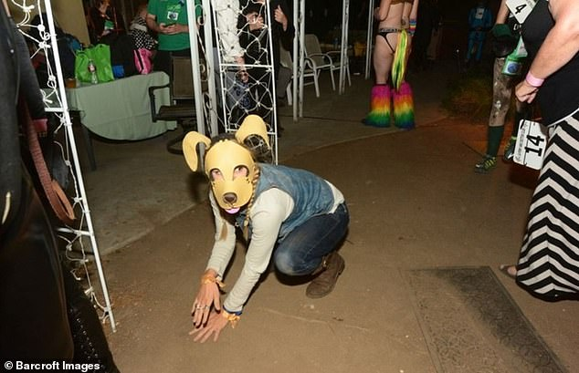 Tony McGinn in dressed in his puppy outfit during a pet play session in Los Angeles