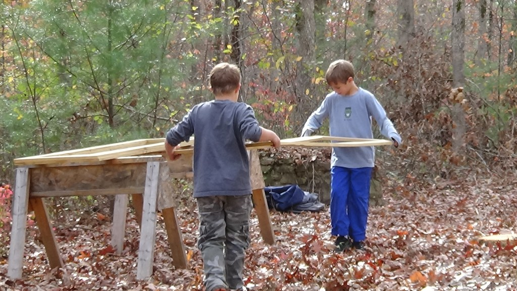 Members of Boy Scout trip 3076 help build and stack aviary doors on Nov. 8, at Cumberland Mountain State Park. (Photo by Diahan Krahulek / Full Sail University)