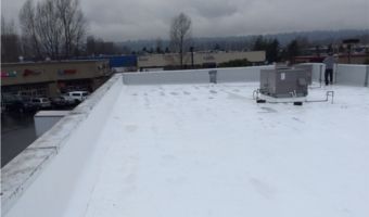 Contractors are working on a new commercial roof in Kirkland
