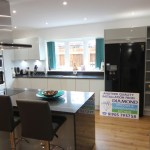 White Gloss Kitchen With Black Granite Worktops Worcester Diamond Kitchens Driotwich
