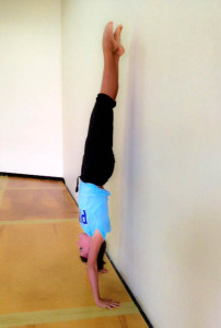 woman doing a hand stand
