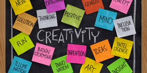 Your Inner Strength: Creativity Blackboard with Post-It Notes listing attributes of creativity