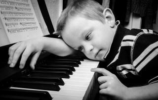 Sad kid at piano