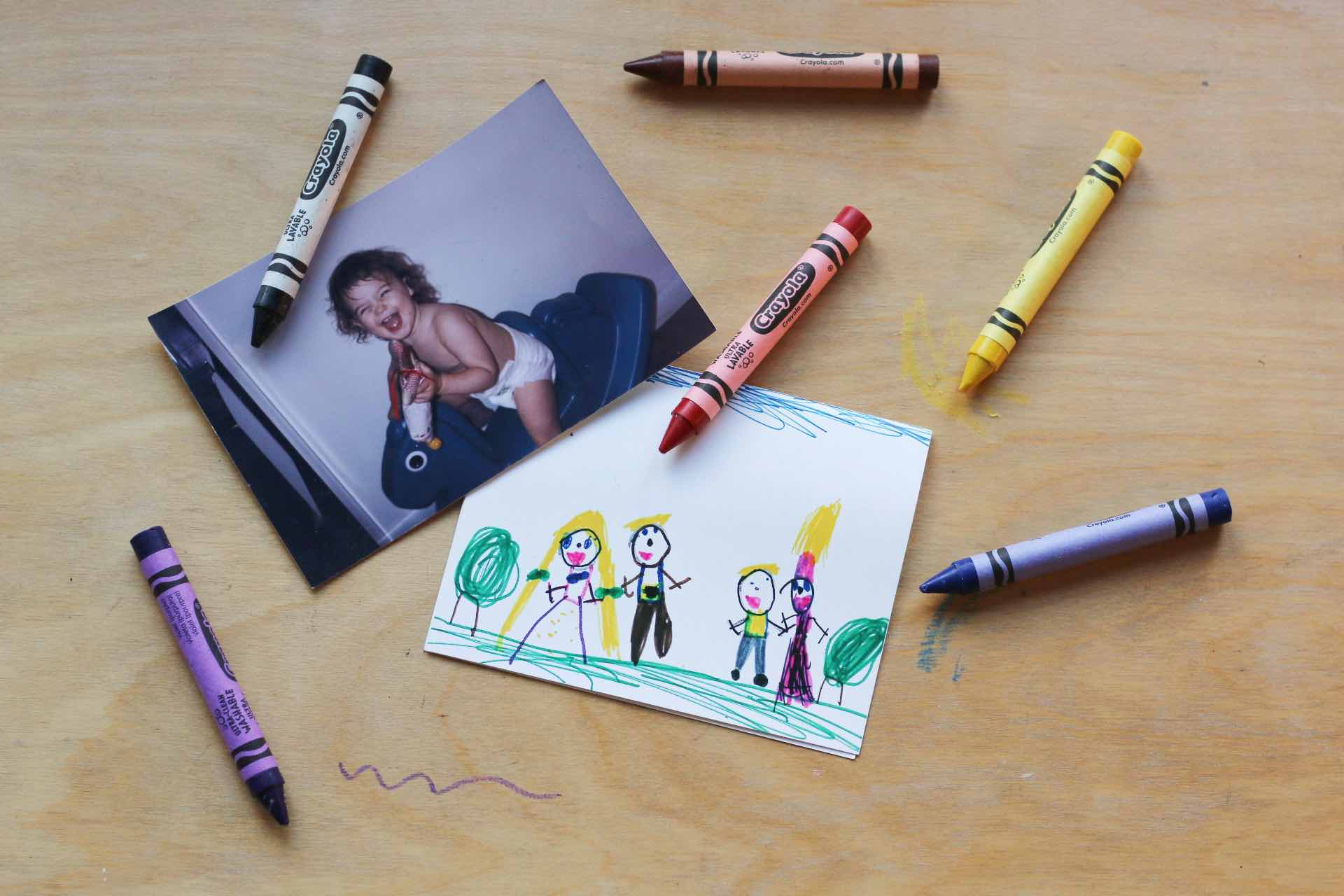 baby photo with crayons and child drawing
