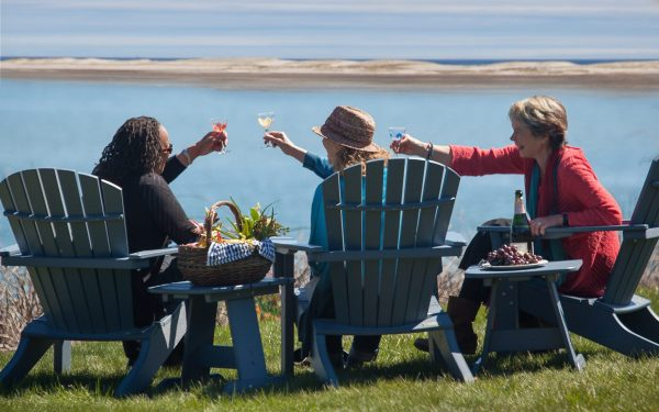 year by the sea women raising a toast