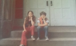 School shooting solutions: Image of two kids on front steps of school.