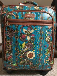 Ireland 101: Image of a colorful carry-on suitcase.
