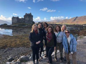 Image of ladies in front of Eilean Donan Castle in Scotland