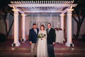 Love, Look at the 2 of us: image of bride and her two brothers.