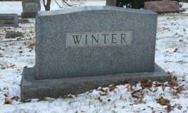 Winter: image of a gravestone marked Winter, in the snow