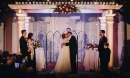 Love, look at the 2 of us: Image of bride and groom kissing