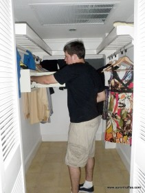 Reaching into the safe in the closet