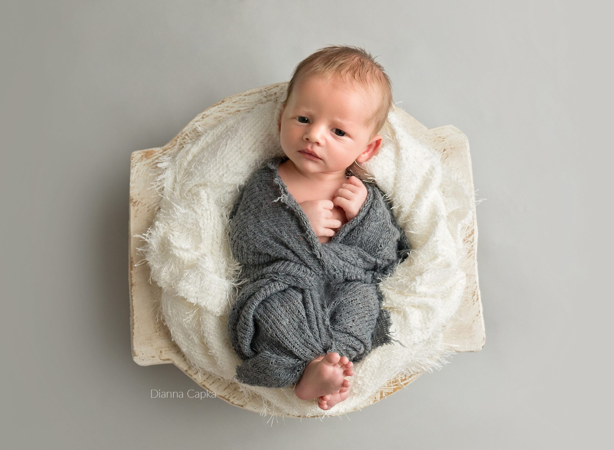awake newborn boy on gray and creme lancaster newborn photographer
