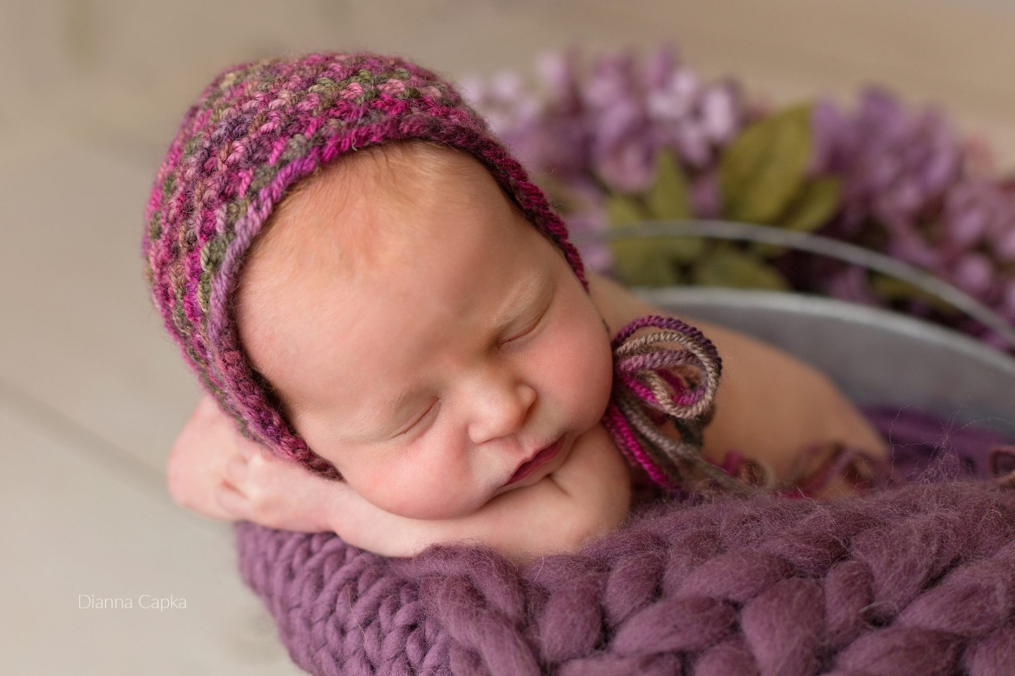 Lancaster newborn photographer newborn girl in mauve plum and flowers