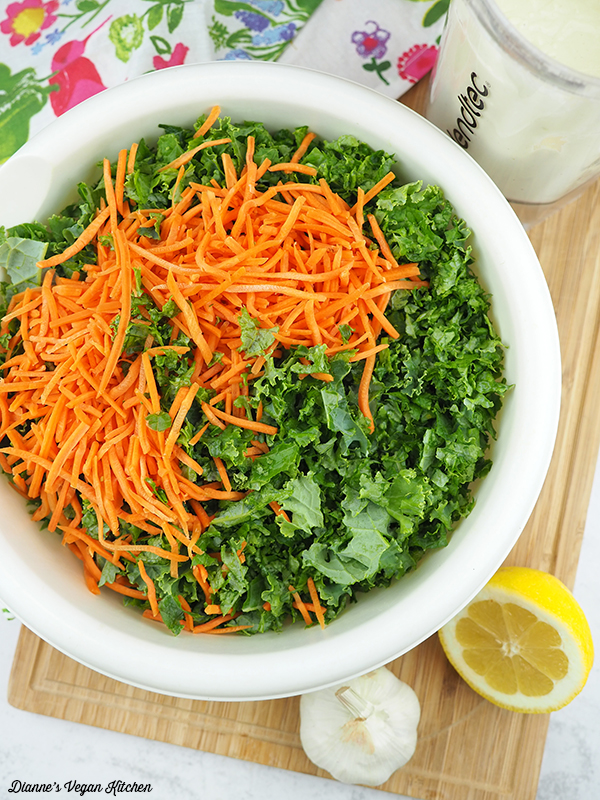 kale and carrots in mixing bowl