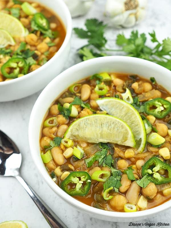 close up of vegan white bean chili in bowl
