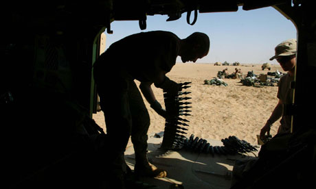 A US soldier with depleted uranium-tipped shells during the second Iraq war. Photograph: John Moore/AP