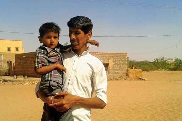 After-effects? Mangi Ram with his son, who cannot speak