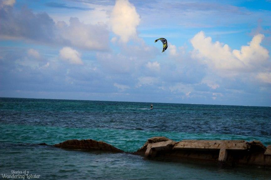 Kite-surfer surfing off the split of Caye Caulker