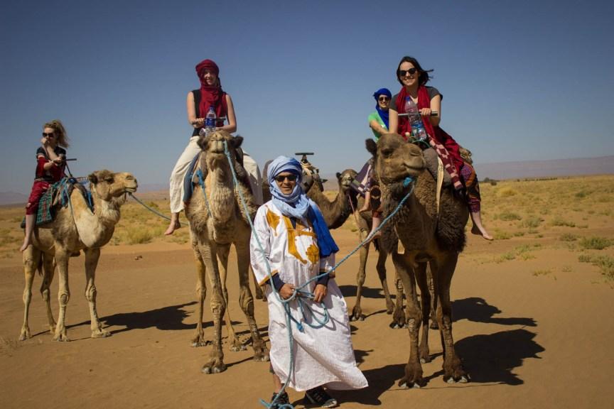 [img] camel riding in the Sahara Desert