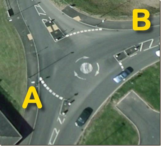 Mini-roundabout on Wilford Lane