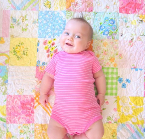 Simple patchwork baby quilt made from Vintage Sheets