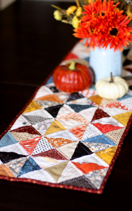 Hourglass Quilt Block Shortcut Video Tutorial by popular Utah quilting blog, Diary of a Quilter: image of a table runner with the hourglass quilt block.