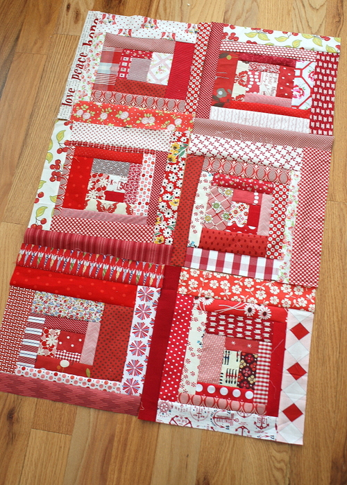 red and white scrappy log cabin blocks