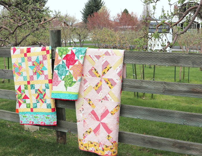 Free Video Class: Strip Piecing Quilt Patterns by popular Utah quilting blog, Diary of a Quilter: image of 3 strip piecing quilts hanging over a wooden fence.