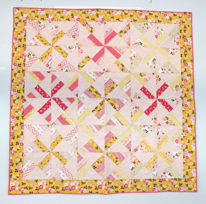 Free Video Class: Strip Piecing Quilt Patterns by popular Utah quilting blog, Diary of a Quilter: image of an hourglass pinwheel quilt.