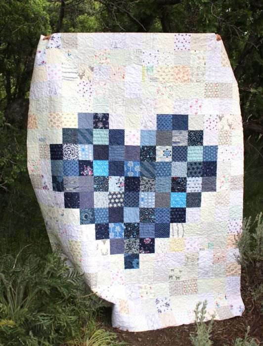 Navy patchwork pixelated heart quilt