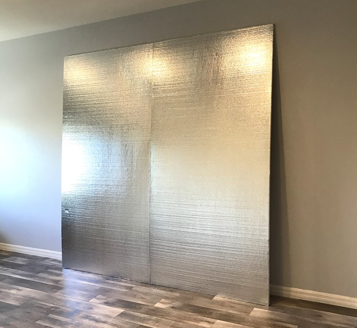 How to Build a Quilt Design Wall by Christa Watson by popular quilting blog, Diary of a Quilter: image of two foam core insulation boards propped up against a wall.