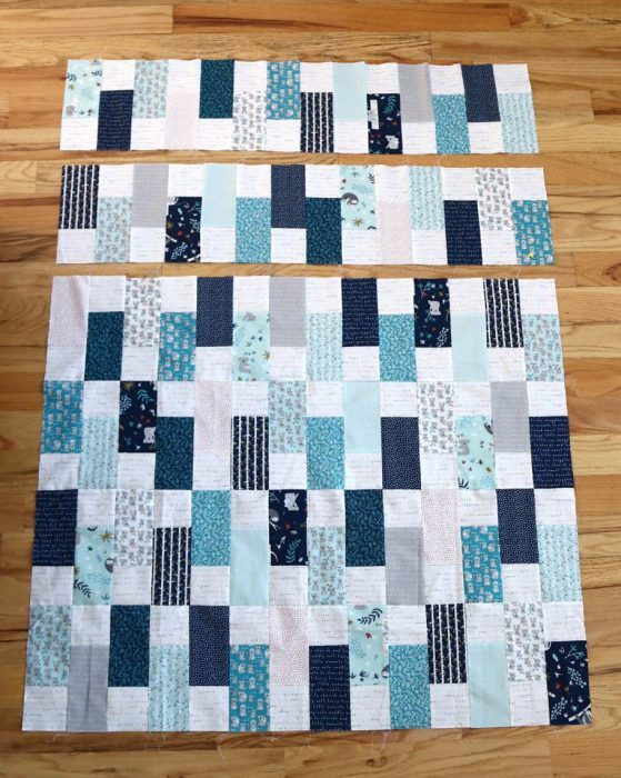 Bricks Baby Quilt Tutorial by popular quilting blog Diary of a Quilter: image of pieced brick units quilting.