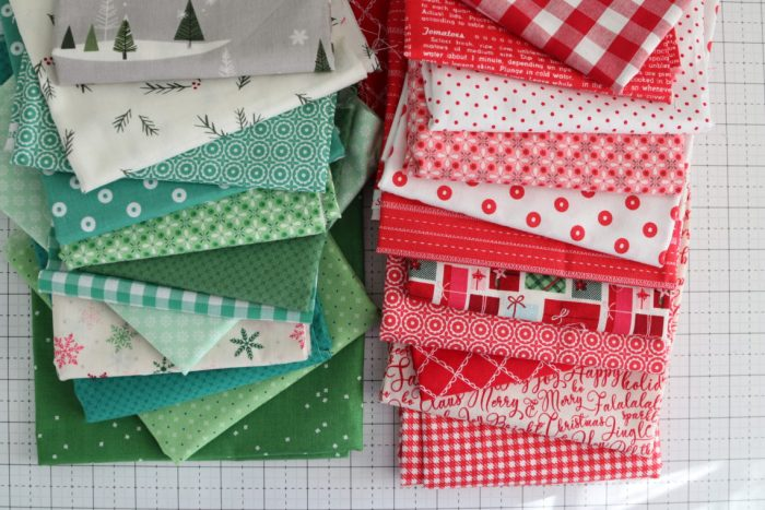 Welcome to the Patchwork Forest Quilt Along! by popular quilting blog, Diary of a Quilter: image of a various red, white, and green Christmas fabrics.