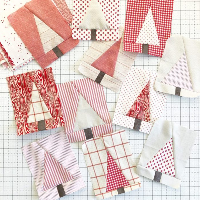Pine Hollow Patchwork Forest Quilt Along Week 3 by popular quilting blog, Diary of a Quilter: image of red and white pine tree fabric squares.