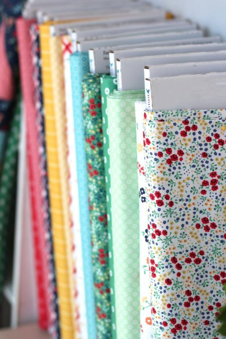 Low Volume prints Sugarhouse Park | Sugarhouse Park Fabric Collection by Amy Smart by popular Utah quilting blog, Diary of a Quilter: image of bolts of Sugarhouse Park fabric.
