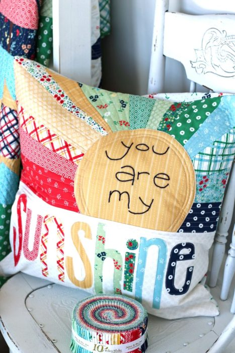 Sugarhouse Park Fabric Collection by Amy Smart by popular Utah quilting blog, Diary of a Quilter: image of a pillow made out of Sugarhouse Park fabric.