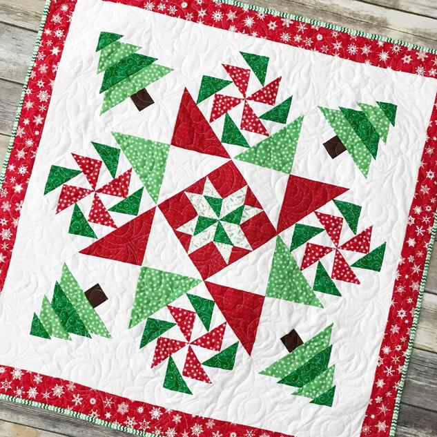 Meet updated Fort Worth Fabric Studio + Giveaway by popular Utah quilting blog, Diary of a Quilter: image of a Christmas mystery quilt.