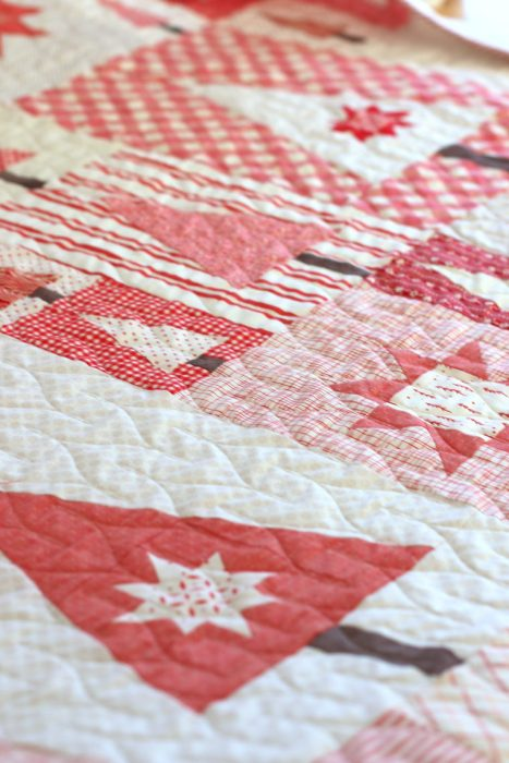 Pine Hollow Patchwork Forest Quilt, a Christmas Quilt featured by top US quilting blog, Diary of a Quilter