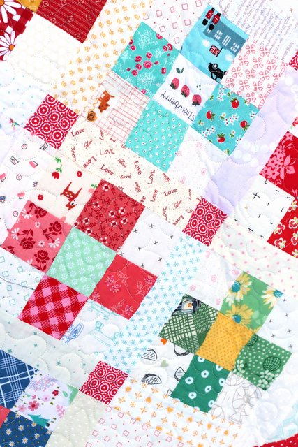 Scrap quilt perfect for fussy-cut squares and for using low-volume prints