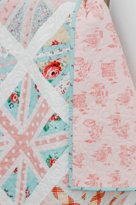 Union Jack baby quilt pattern featuring pink London toile fabric on the back
