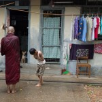 Even the young treat the monks with reverence.
